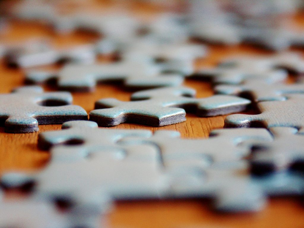 Close up of jigsaw puzzle pieces on a table